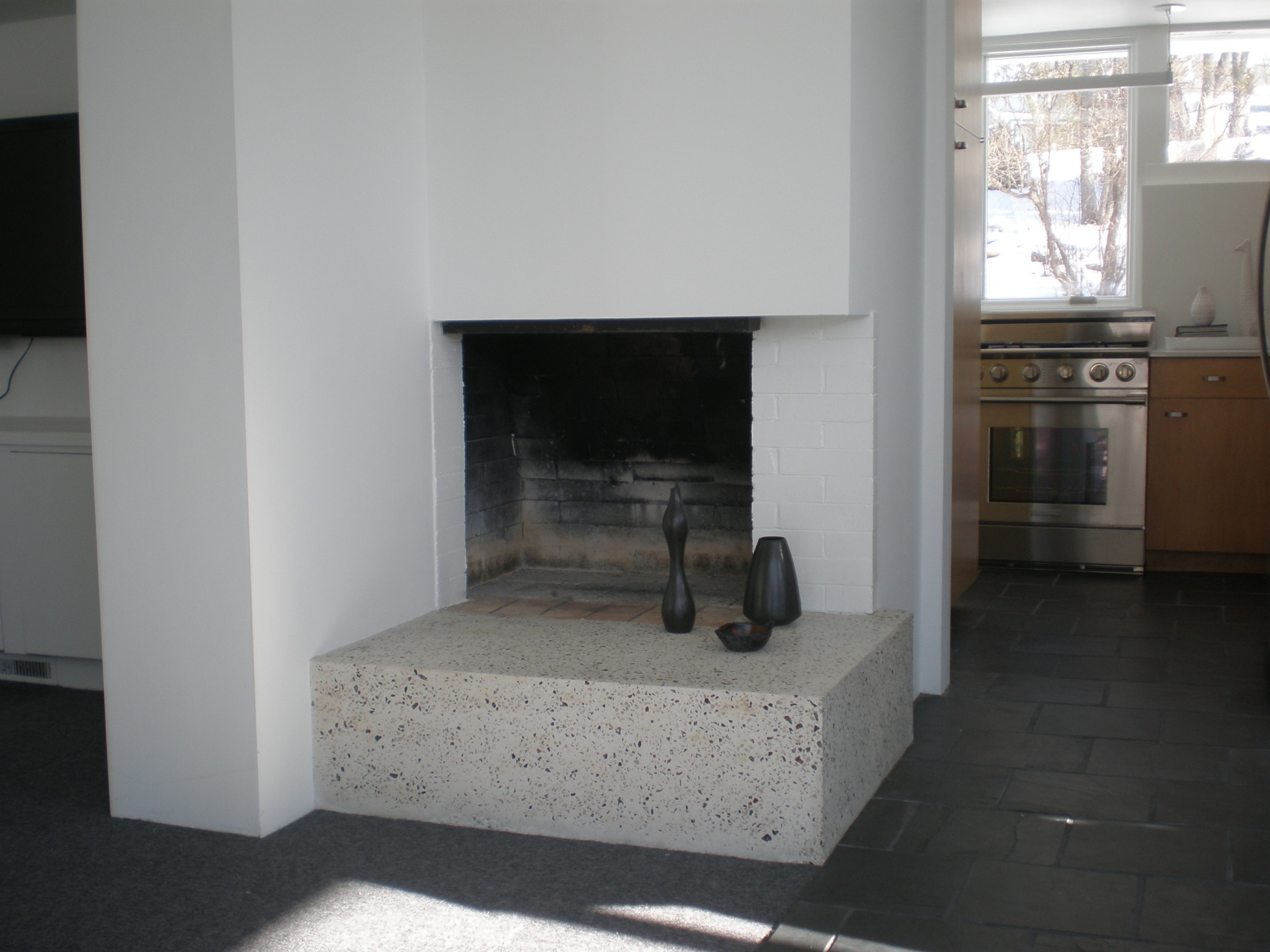 Home remodel in Edina, MN. with concrete fireplace hearth